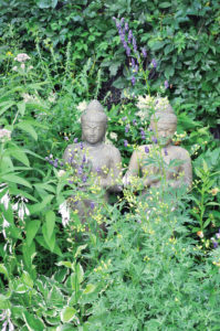 Buddhist statues can be found throughout the garden.